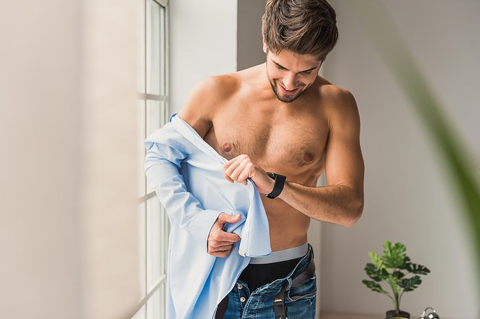 fit man taking off his shirt