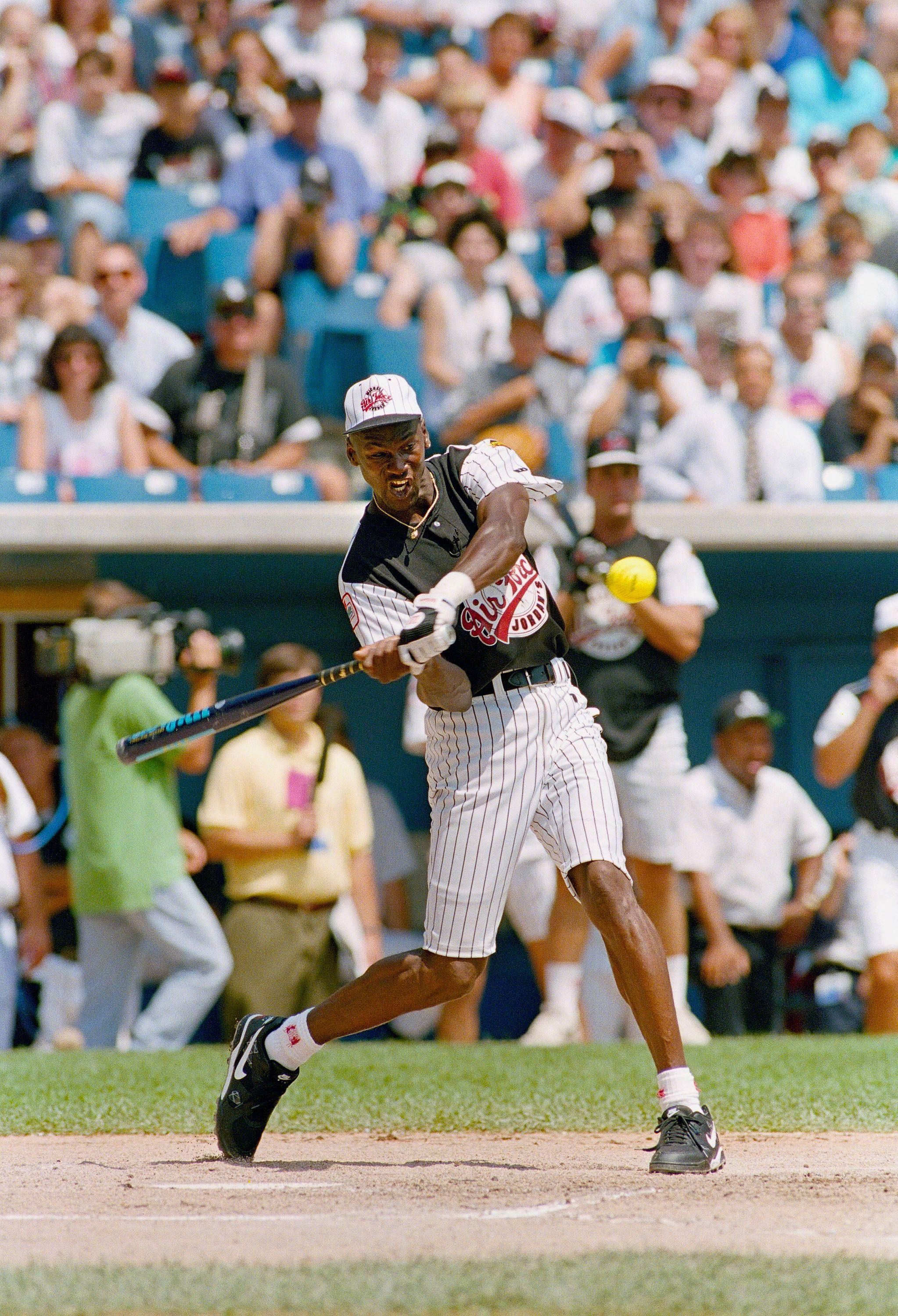Mandatory Credit: Photo by John Swart/AP/Shutterstock (6564145a) Chicago Bull's basketball player Michael Jordan swings during a celebrity softball game, at Comiskey Park in Chicago. Jordan and a group of his friends played Michael Bolton and his band before the start of the Chicago White Sox and Milwaukee Brewers game Michael Jordan Baseball, Chicago, USA