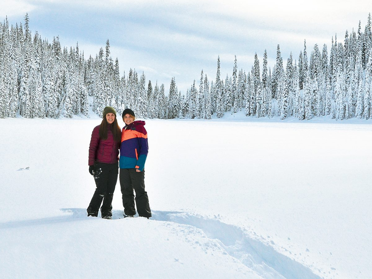 Canadian winter - two young women at Poland Lake, B.C.
