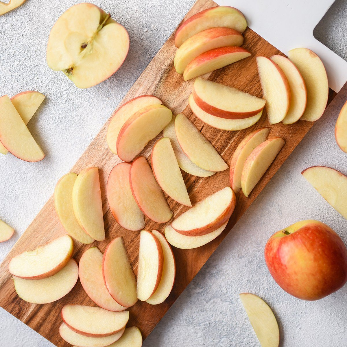 Sliced Apples on a Wooden Chopping Board; Shutterstock ID 1370470283; Job (TFH, TOH, RD, BNB, CWM, CM): TOH