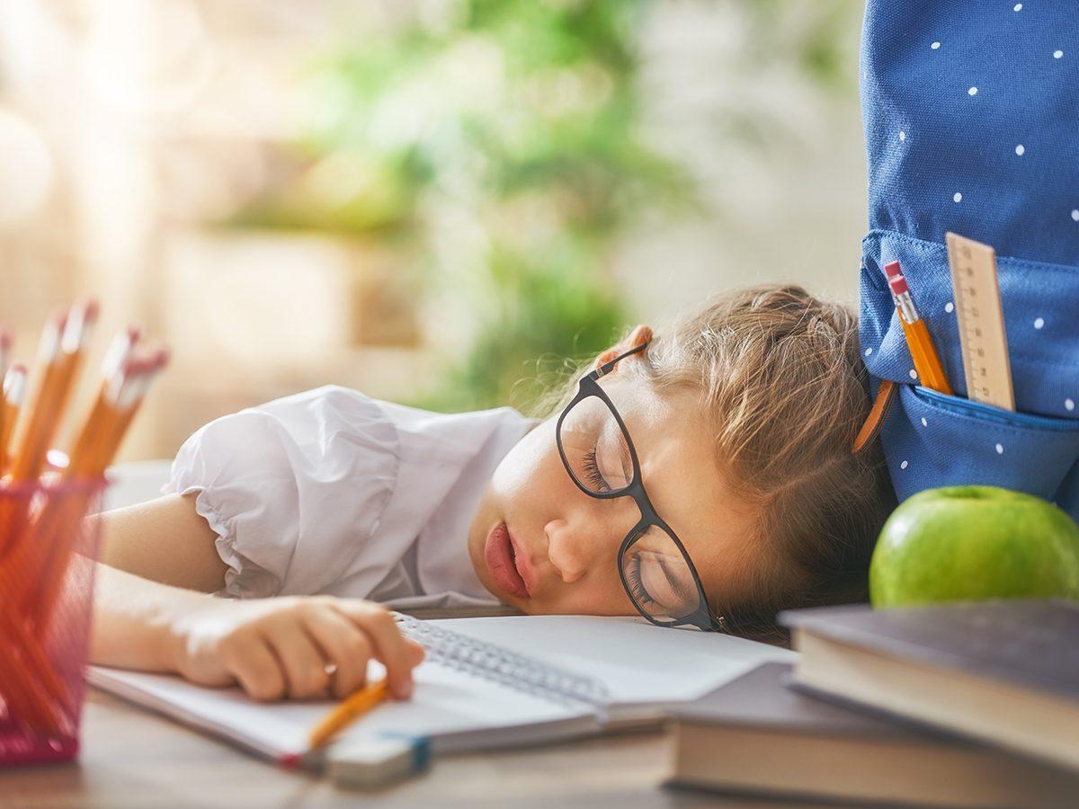 Funny parenting tweets - tired kid sleeping at desk