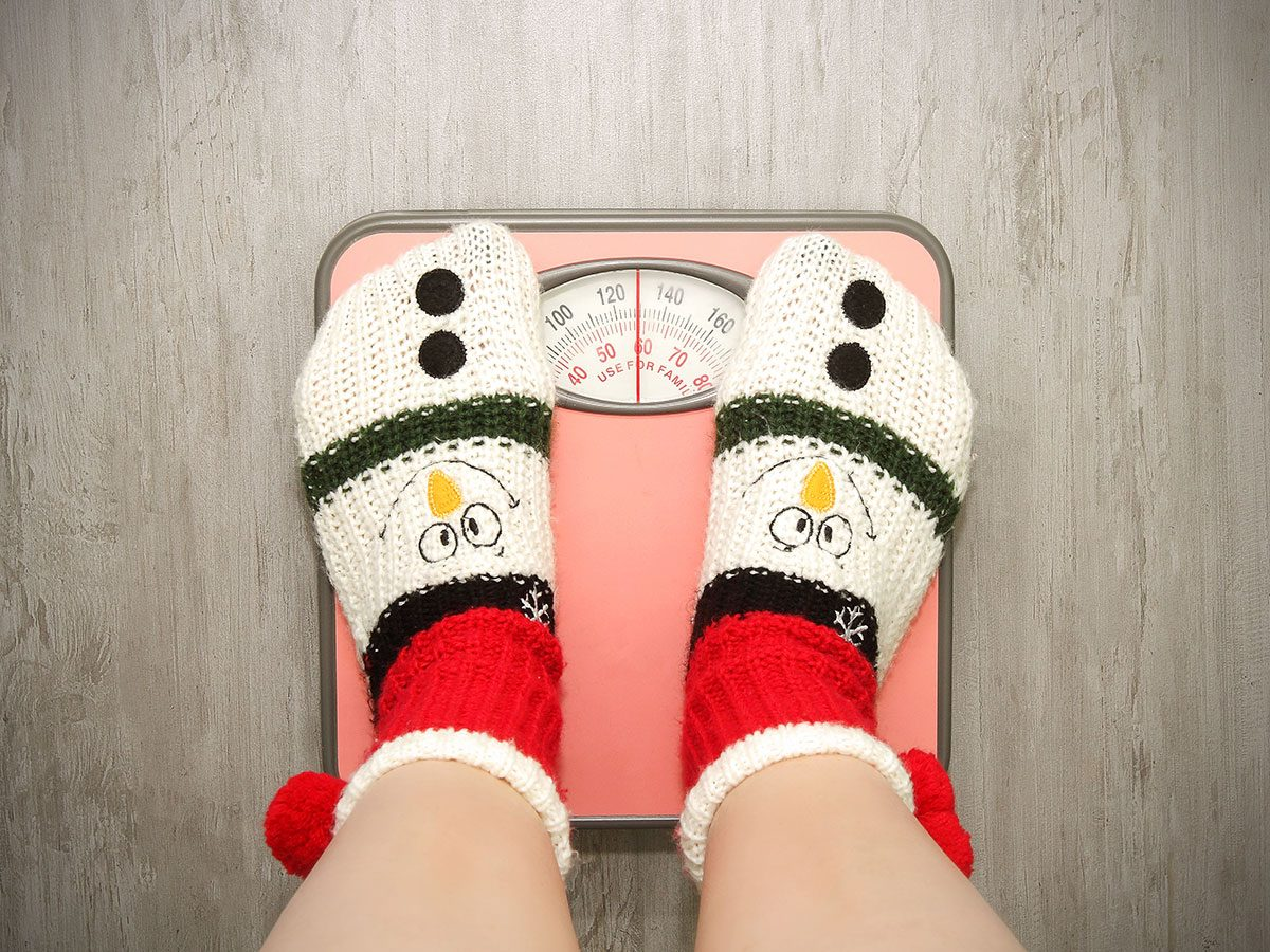 Holiday disasters - Christmas overeating weigh on scale