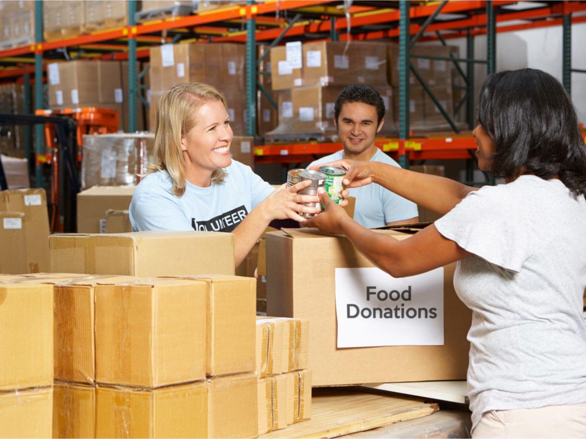 Woman donating to food bank