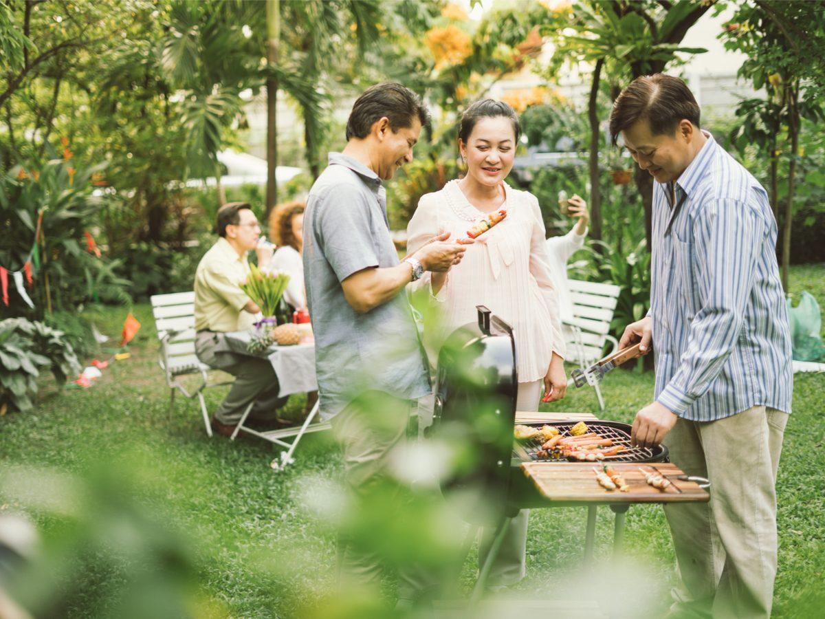 Happy family eating in backyard