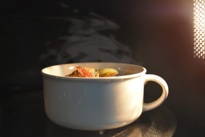 Look inside the microwave food white bowl, In a warm atmosphere and empty top space for text. - Non color ceramic is applicable