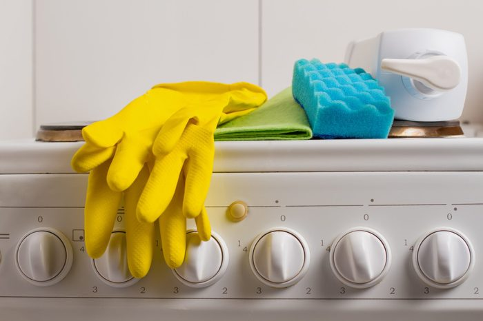 Detergents for the kitchen are on the stove.