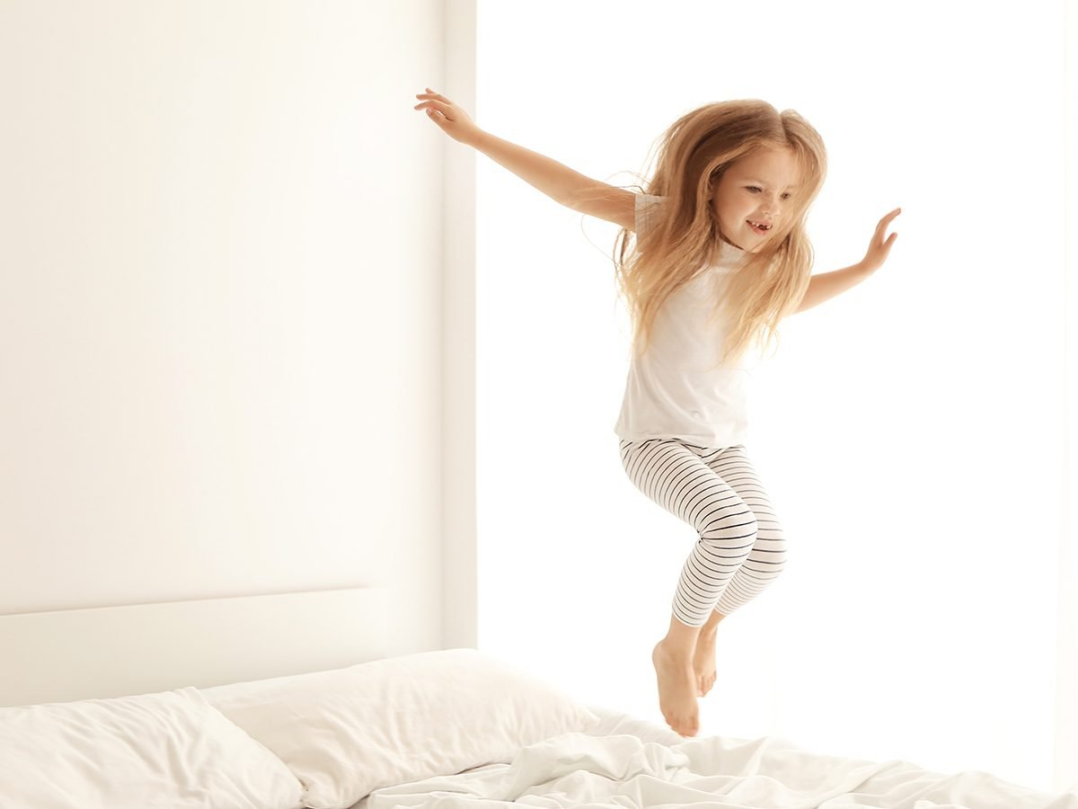 Little girl jumping on bed - funny parenting Tweets