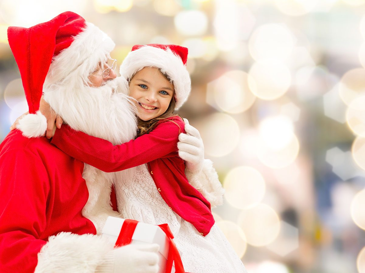 Little girl with Santa at Christmas
