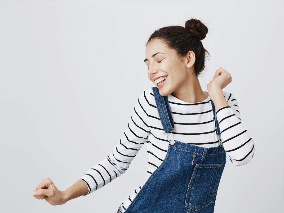 Magnesium benefits: attractive woman in a happy mood