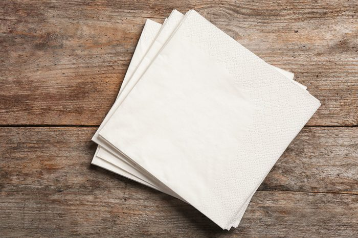 Clean napkins on wooden background, top view with space for text