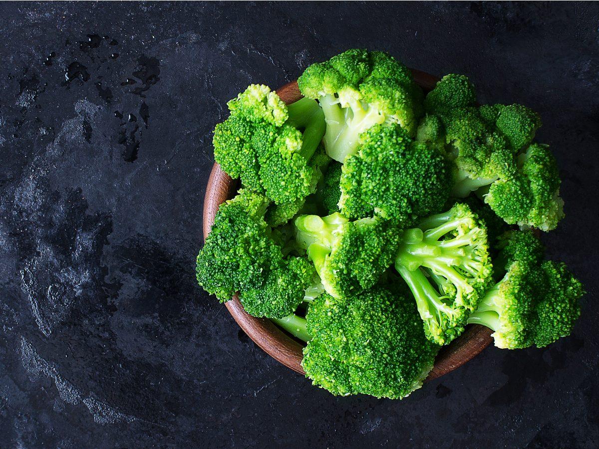 Bowl of broccoli on black table