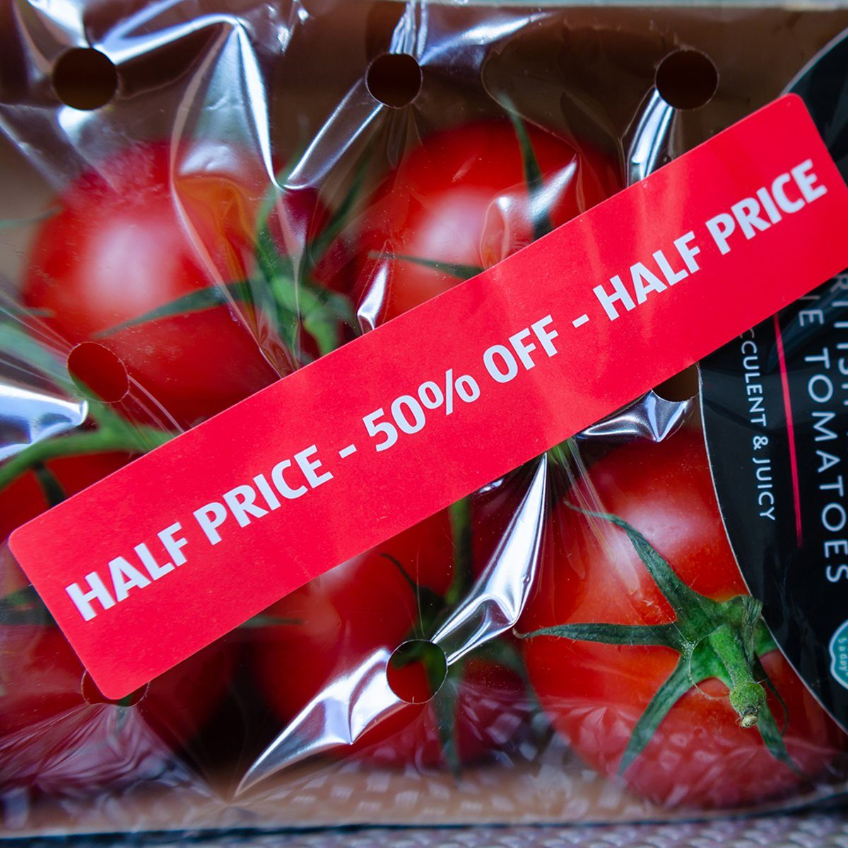 "Stone, Staffordshire / UK - July 1 2019: Pack of British Regal Vine Tomatoes with discount label from ALDI supermarket. Short dated vegetables on clearance are with label: ""Half price, 50% off""; Shutterstock ID 1439340539; Job (TFH, TOH, RD, BNB, CWM, CM): TOH"