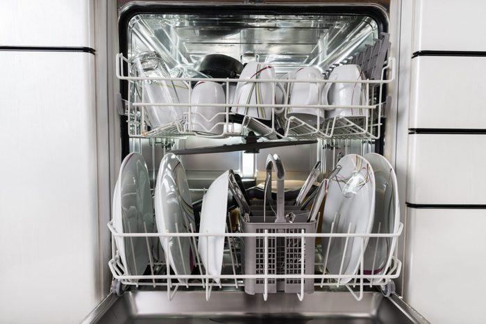 Photo Of Utensils Arranged In Dishwasher In Kitchen