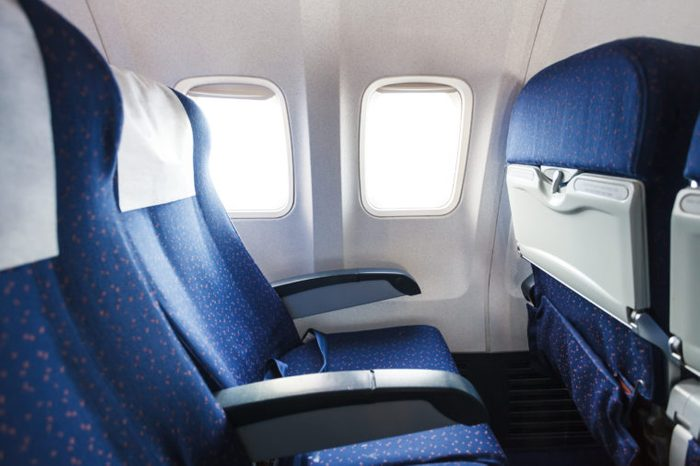 blue seats in economy class passenger section of airplane
