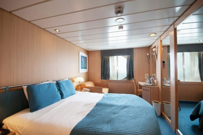 Interior of an ocean view cruise ship cabin