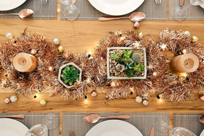 Metallic Holiday rustic table setting with succulents from above