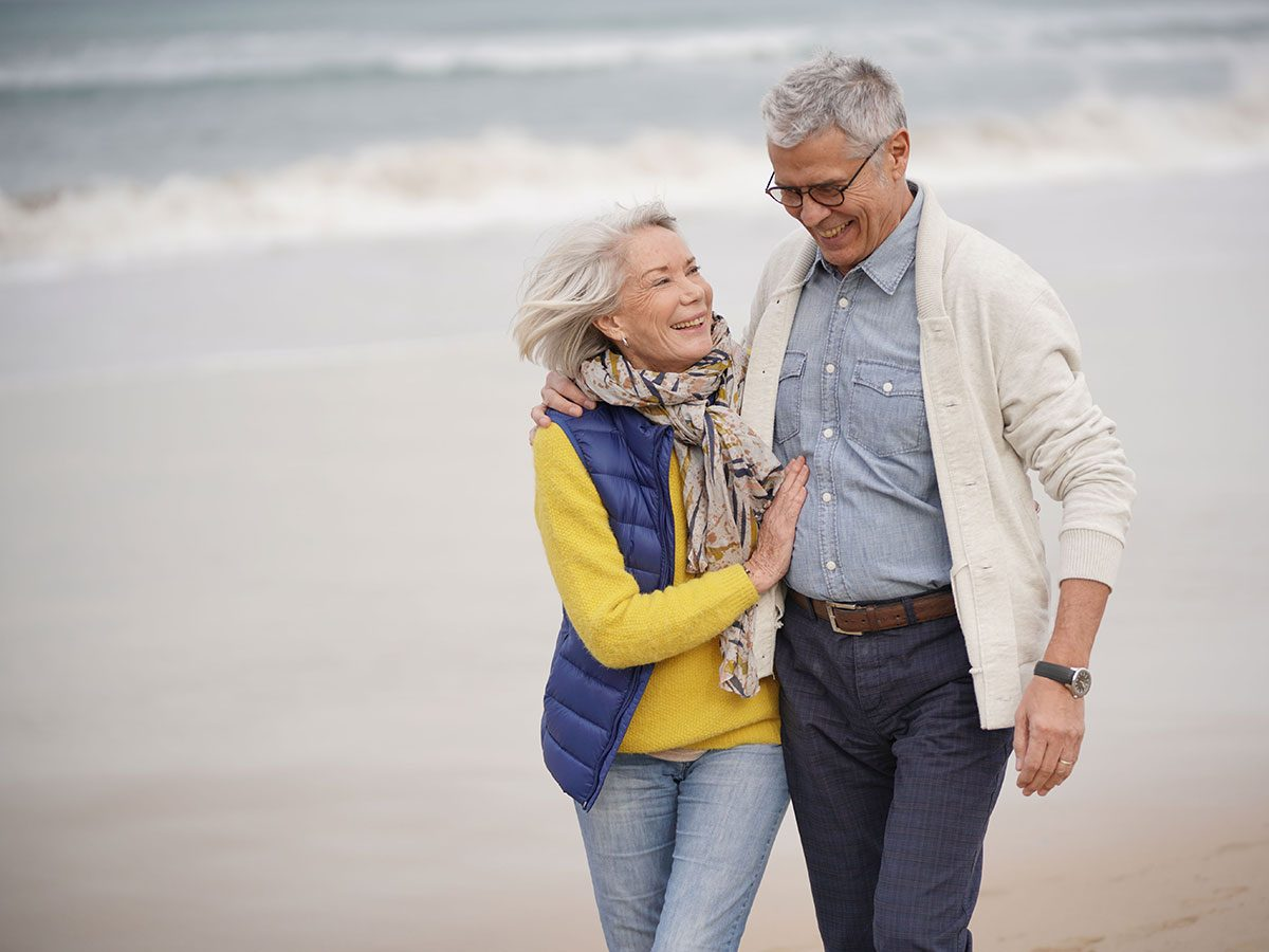 Walking 10,000 steps a day - senior couple at beach