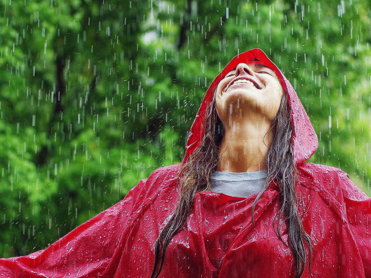 Health benefits of meditation - woman in rain happy
