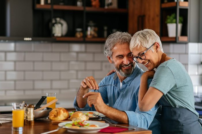 Happy senior couple enjoying a leisurely breakfast together at home