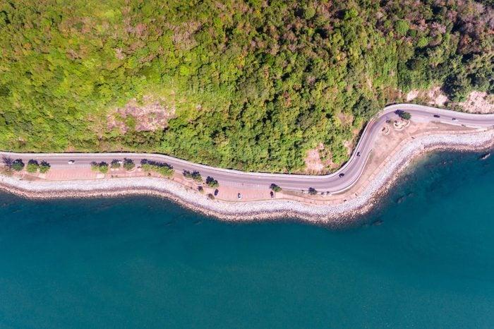 Aerial view of road on sea coastal.