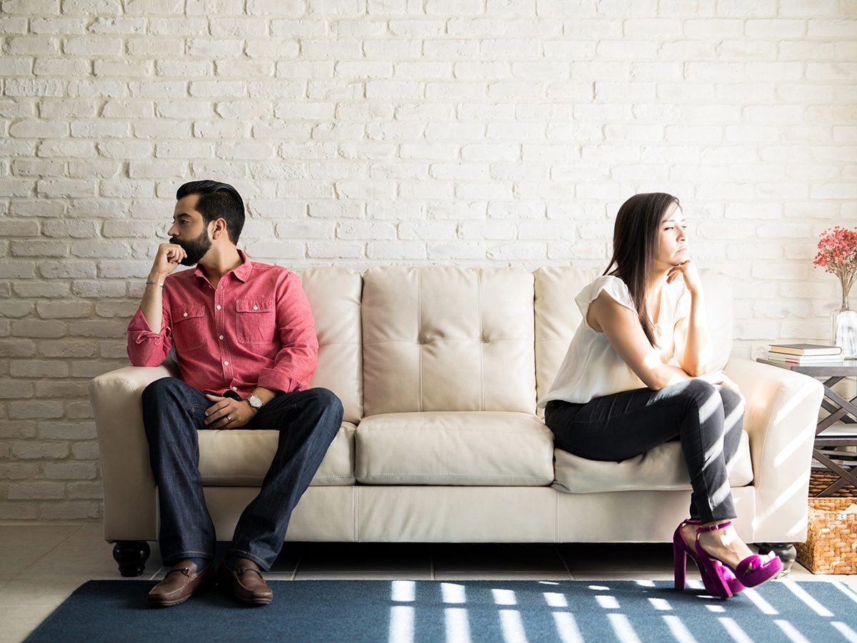 Things To Never Do After Fight - Couple sitting on couch away from each other