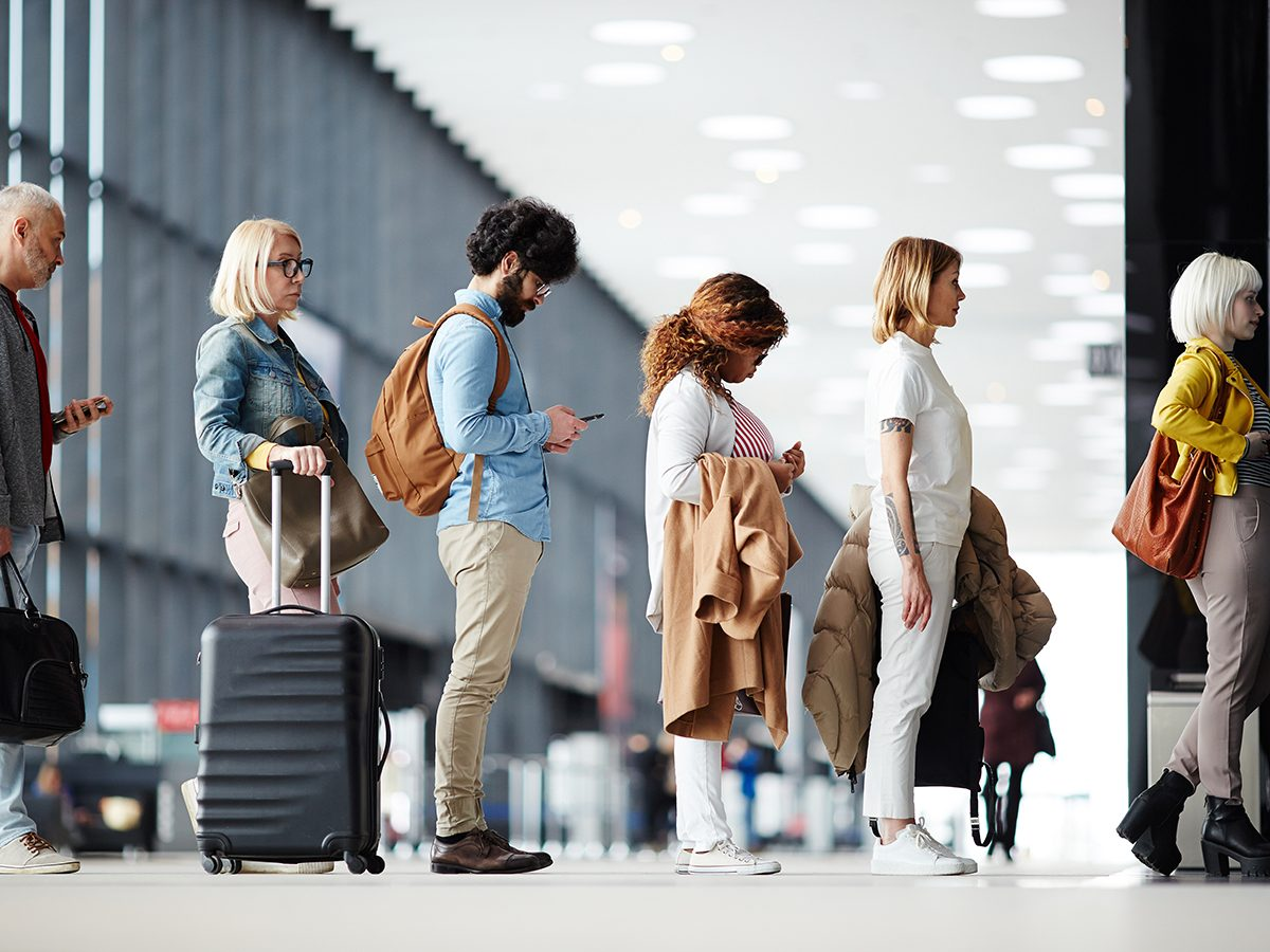 Airport - airplane passengers waiting in line