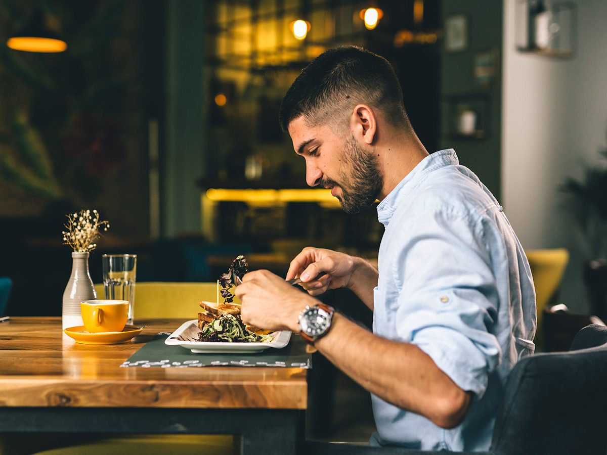Benefits of being alone - man dining alone at restaurant