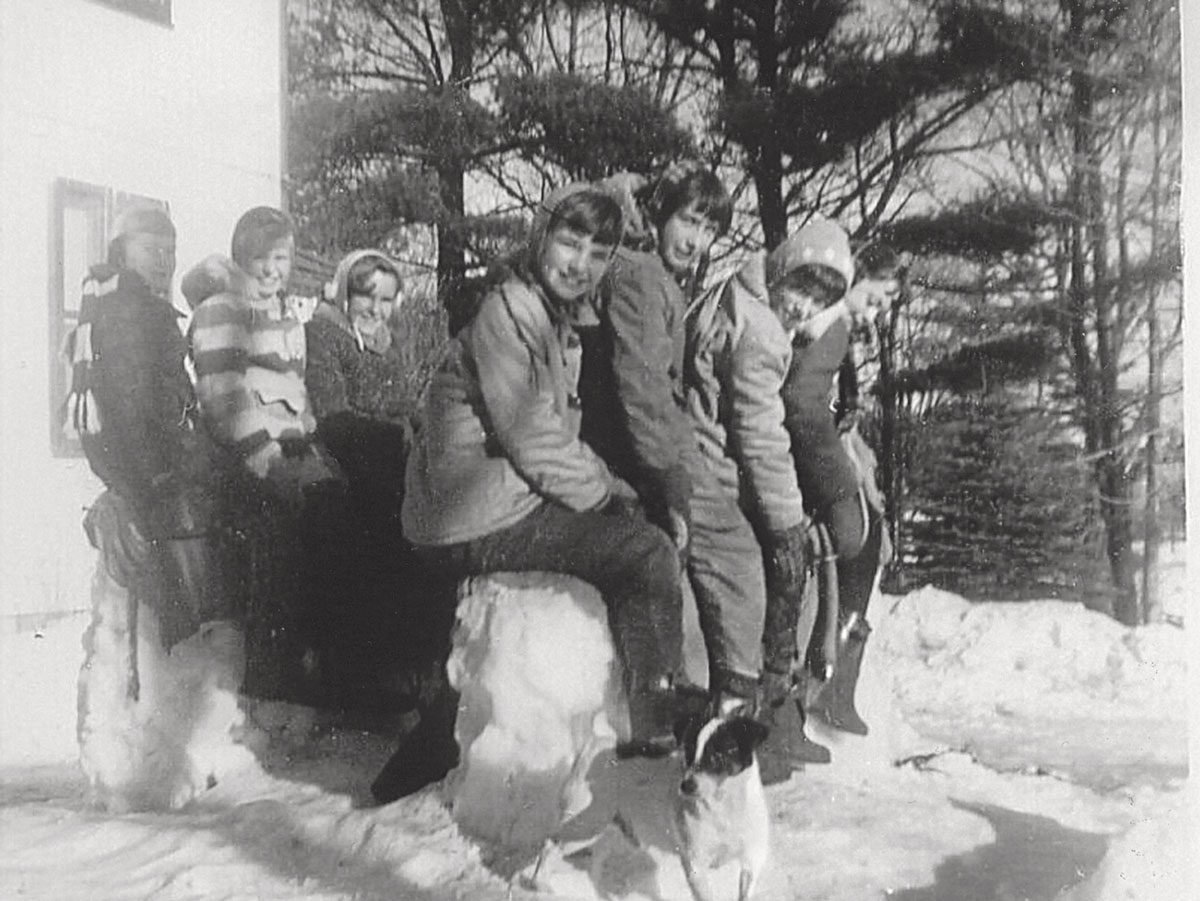 The gang perched on a couple of snow horses