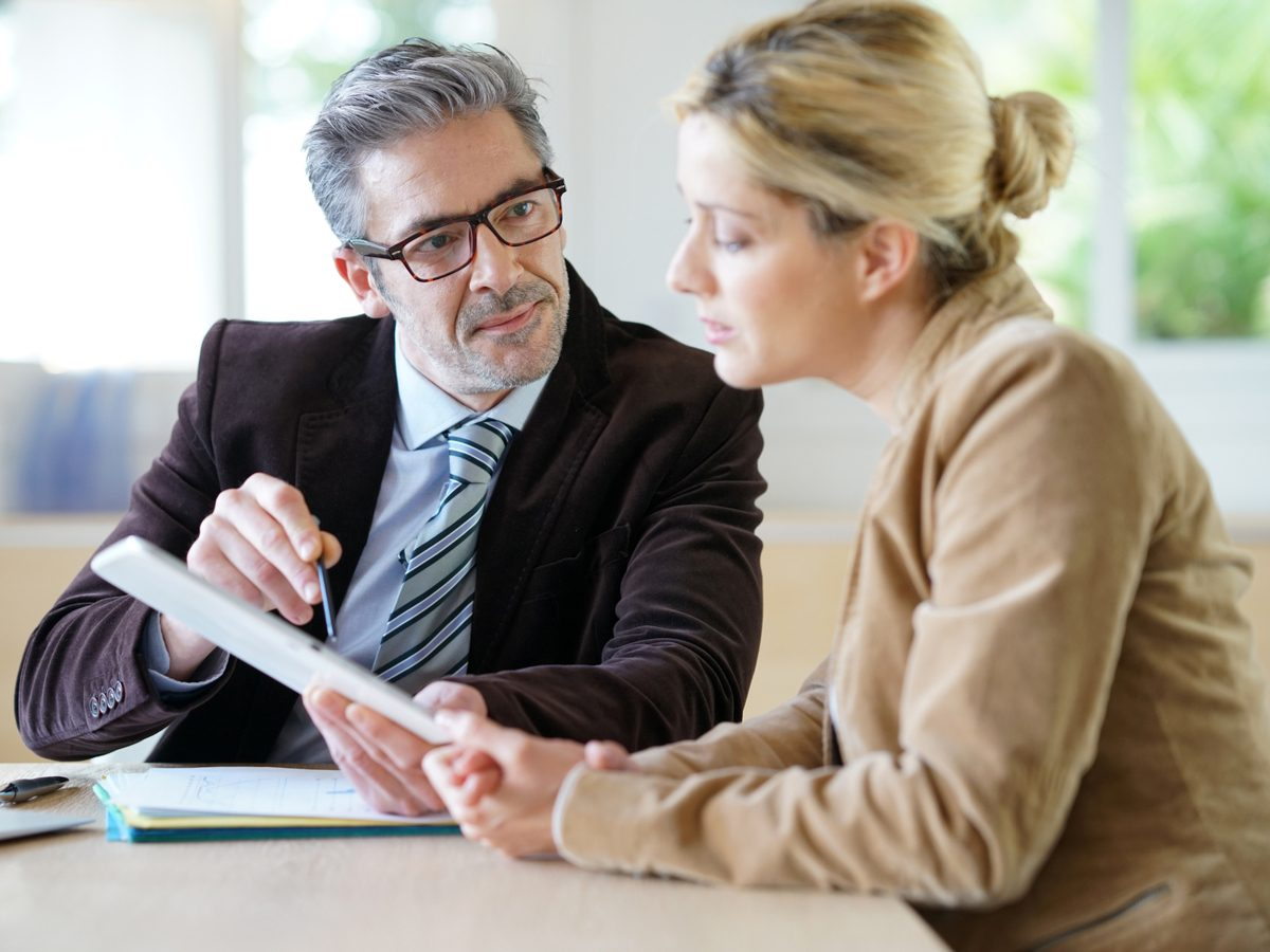 Financial advisor with his female client
