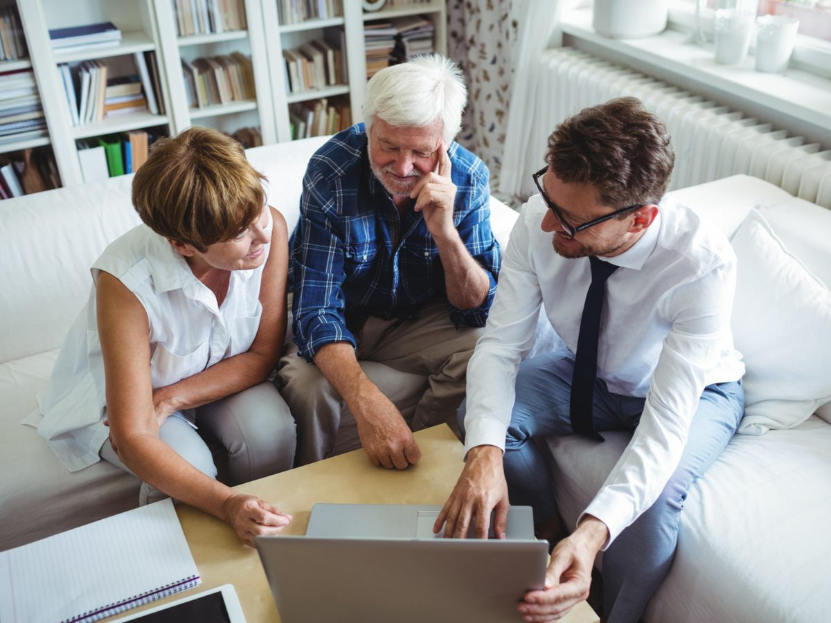 Financial advisor with senior couple