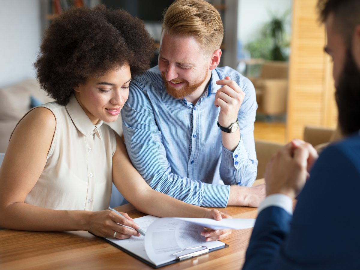 Young couple meeting with a financial advisor