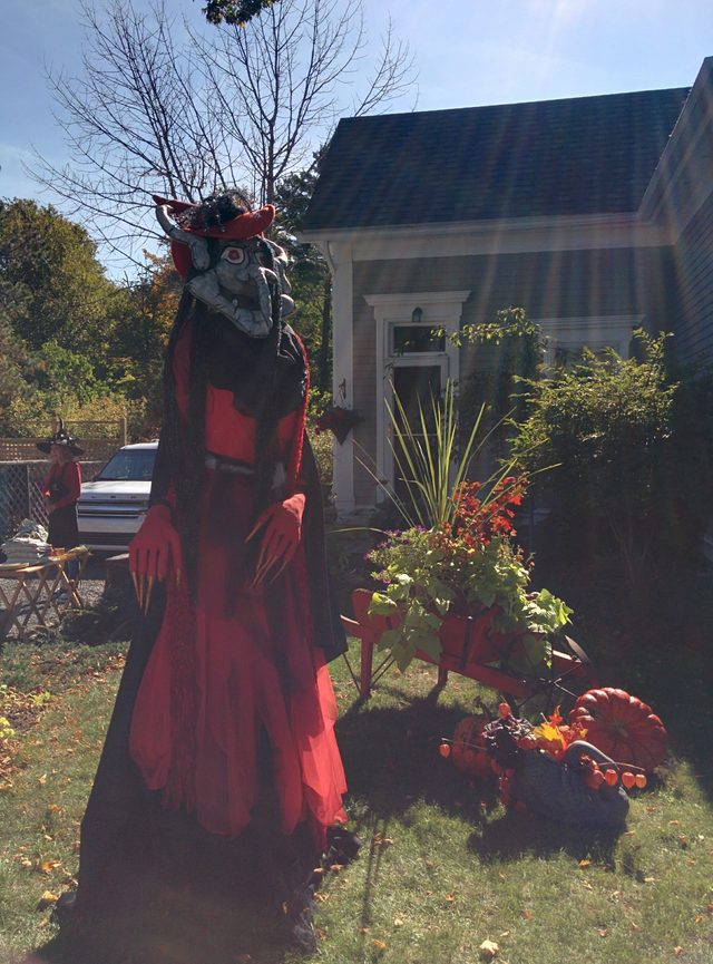 Scarecrow in red dress