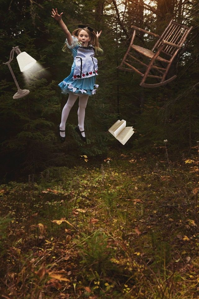 Girl in an Alice costume jumping in the air