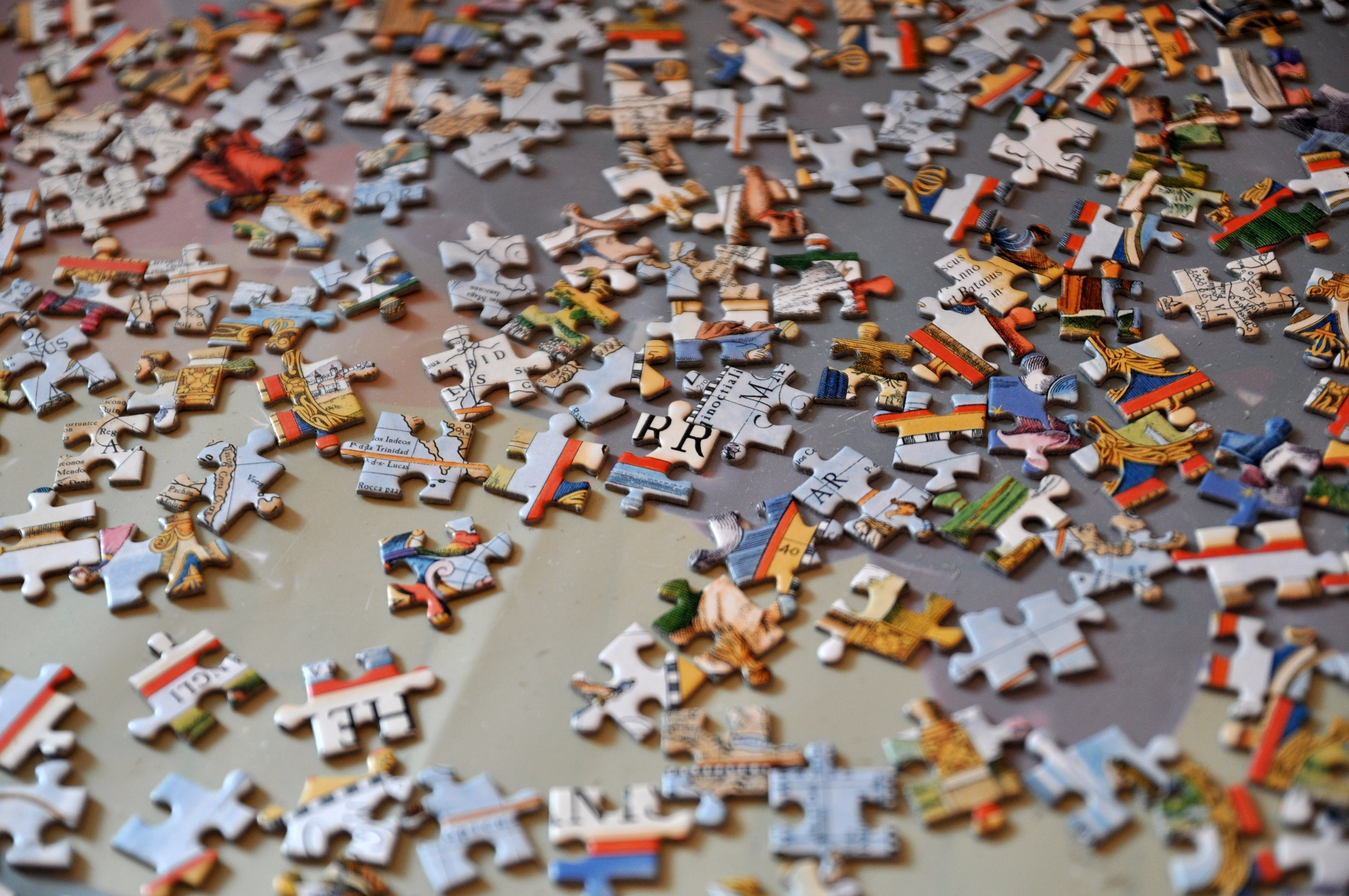 Jigsaw puzzle on the floor.Puzzle pieces.A pile of puzzle pieces on a surface.
