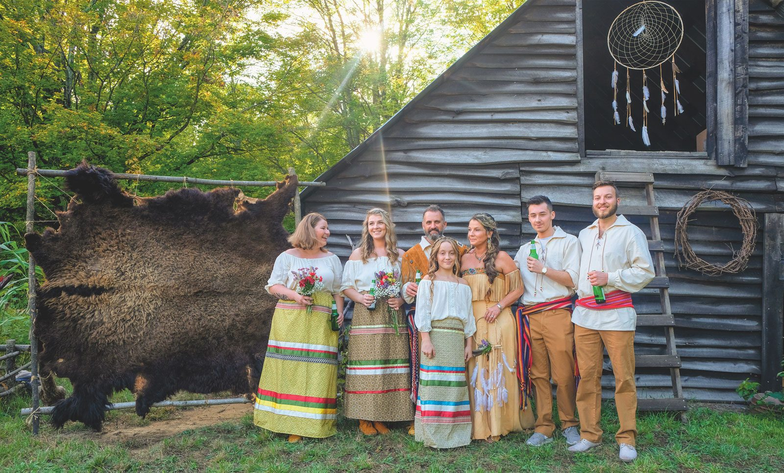 The happy family decked out in traditional Métis clothing, most of which Lisa created