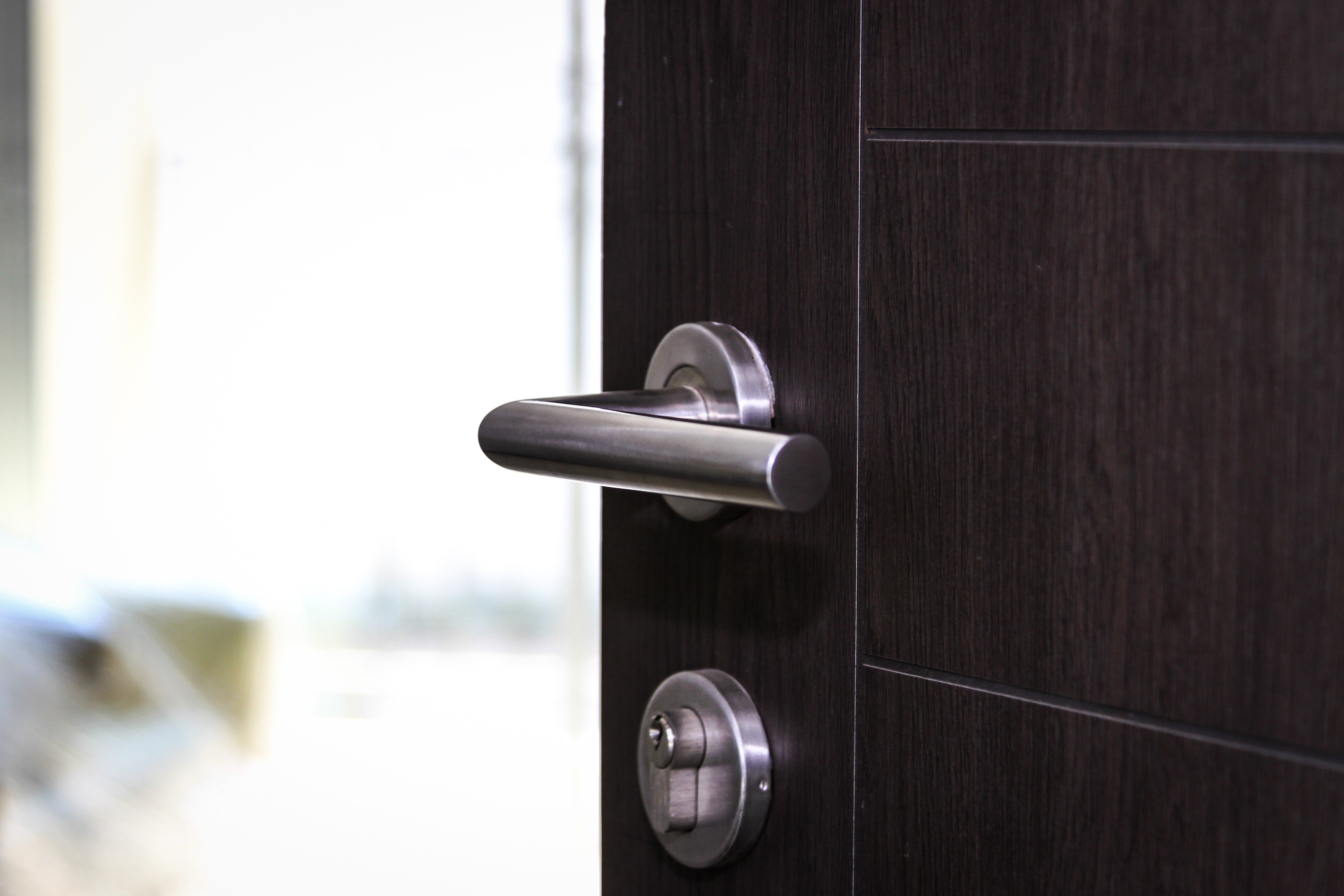 Modern, contemporary steal handle and keyhole detail