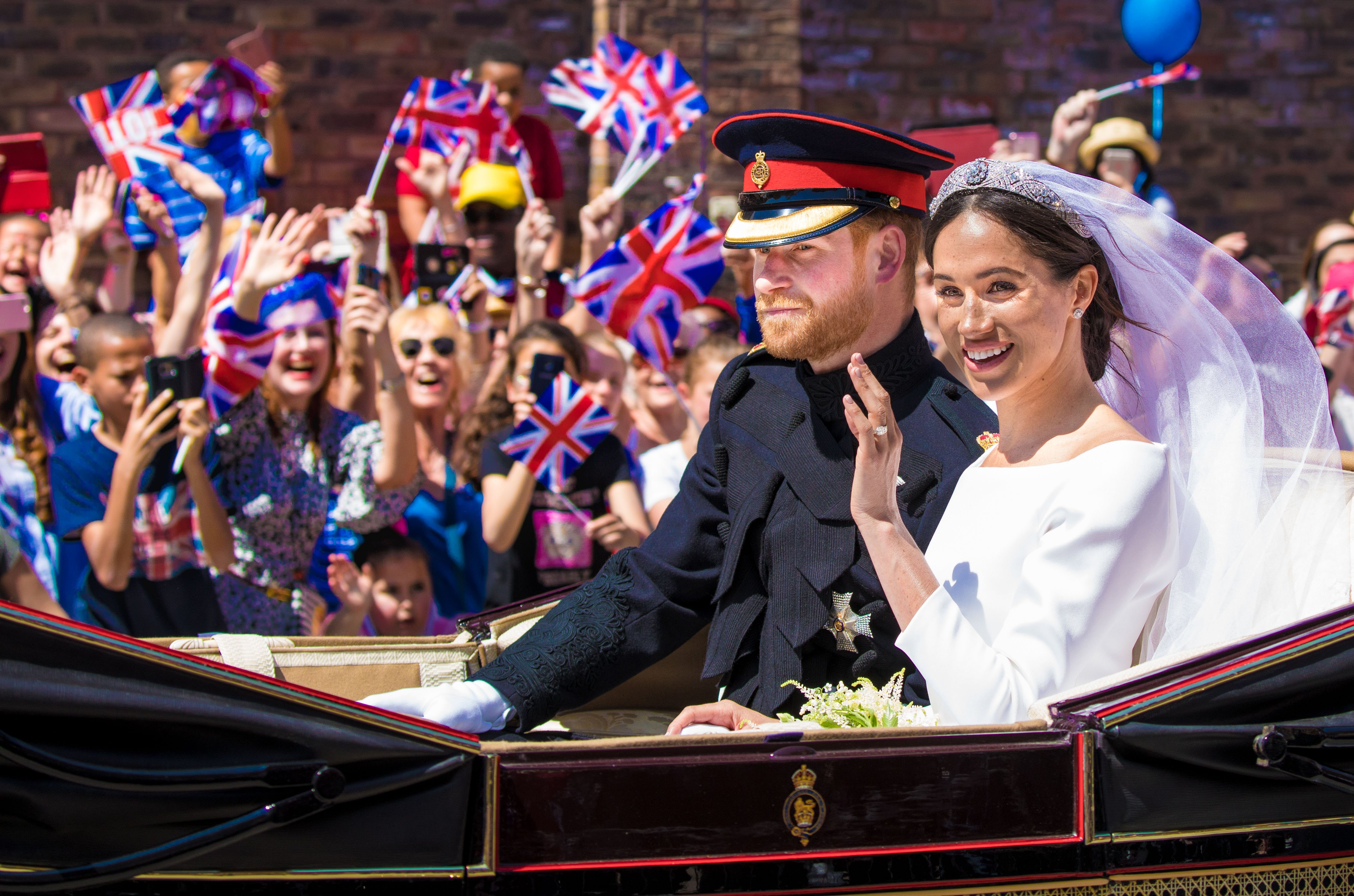 Mandatory Credit: Photo by Shutterstock (9686355b) Prince Harry and Meghan Markle during the Carriage Procession of their wedding in Windsor, Berkshire, UK. The wedding of Prince Harry and Meghan Markle, Windsor, UK - 19 May 2018