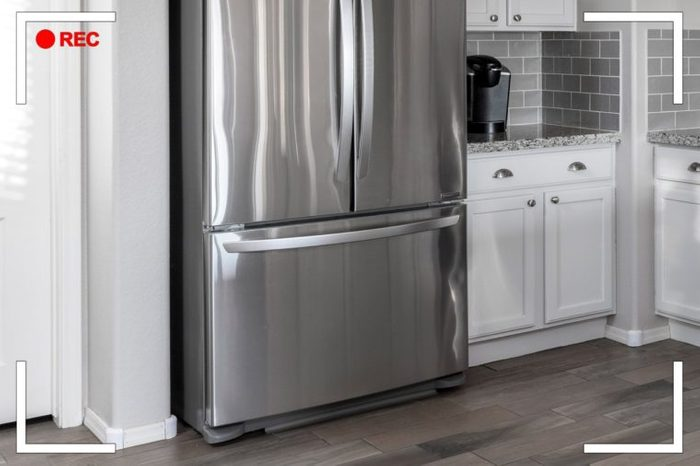 close up on refrigerator with bottom drawer freezer in a kitchen.