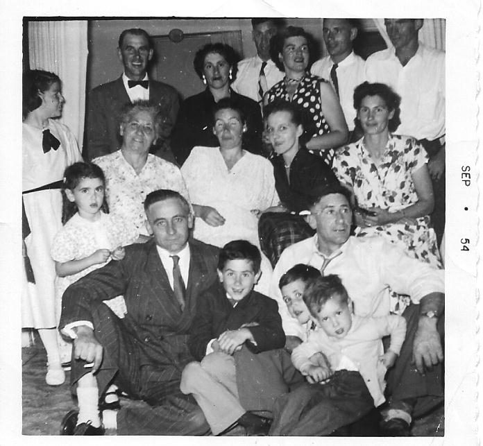 Black and white photo of an extended family gathered at Christmas