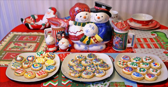 Three plates of Christmas-themed cookies