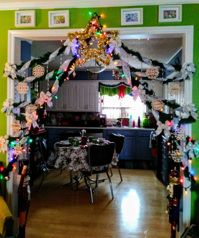Garlands hanging at threshold to kitchen