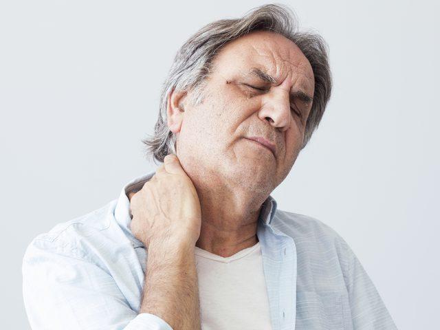 Senior man holding neck