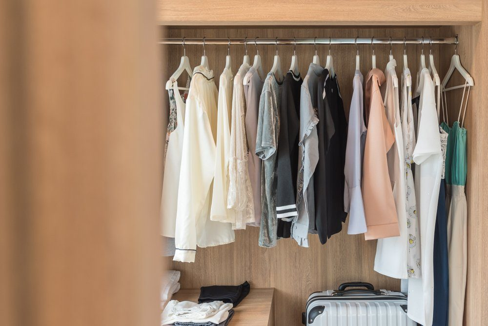 wooden closet with clothes hanging on rail, wardrobe interior design