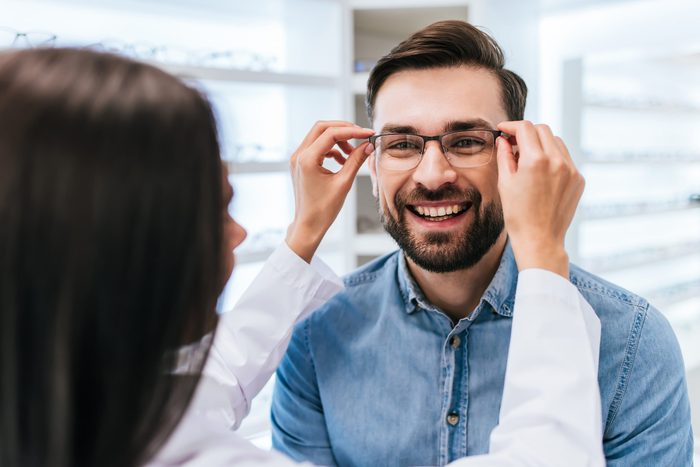 Signs you need new glasses - Doctor and patient in modern ophthalmology clinic