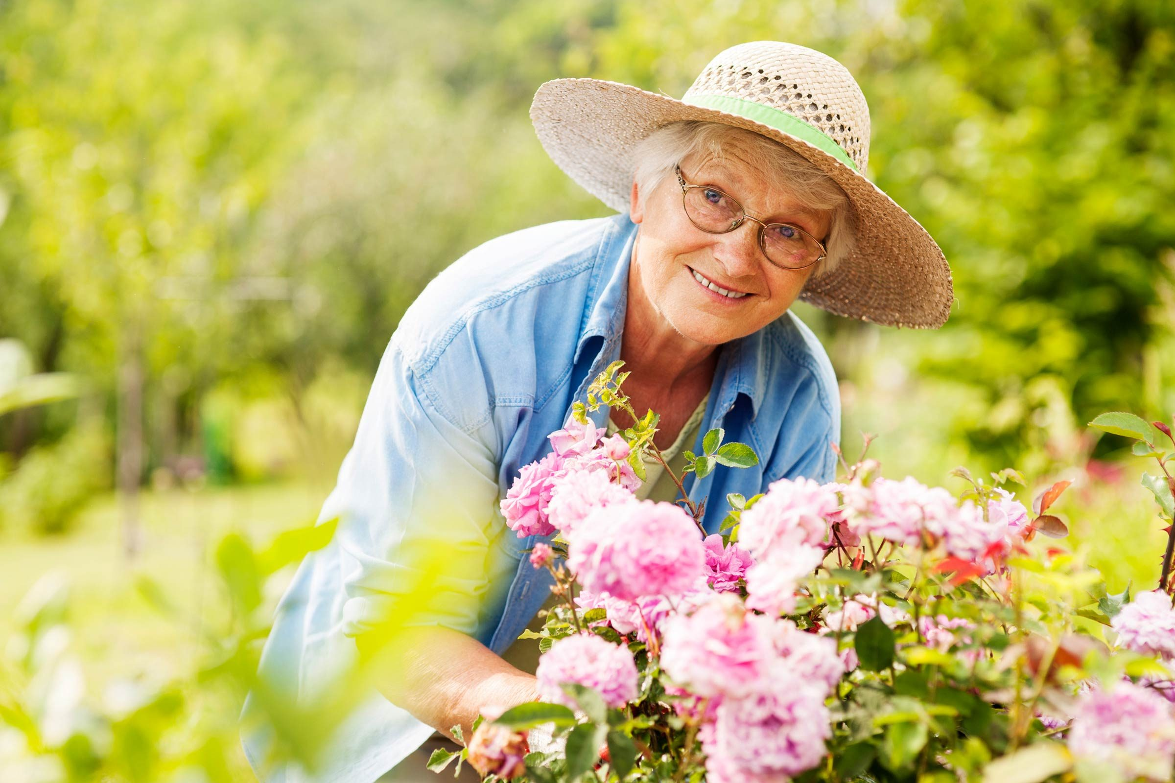 Senior woman happily gardening