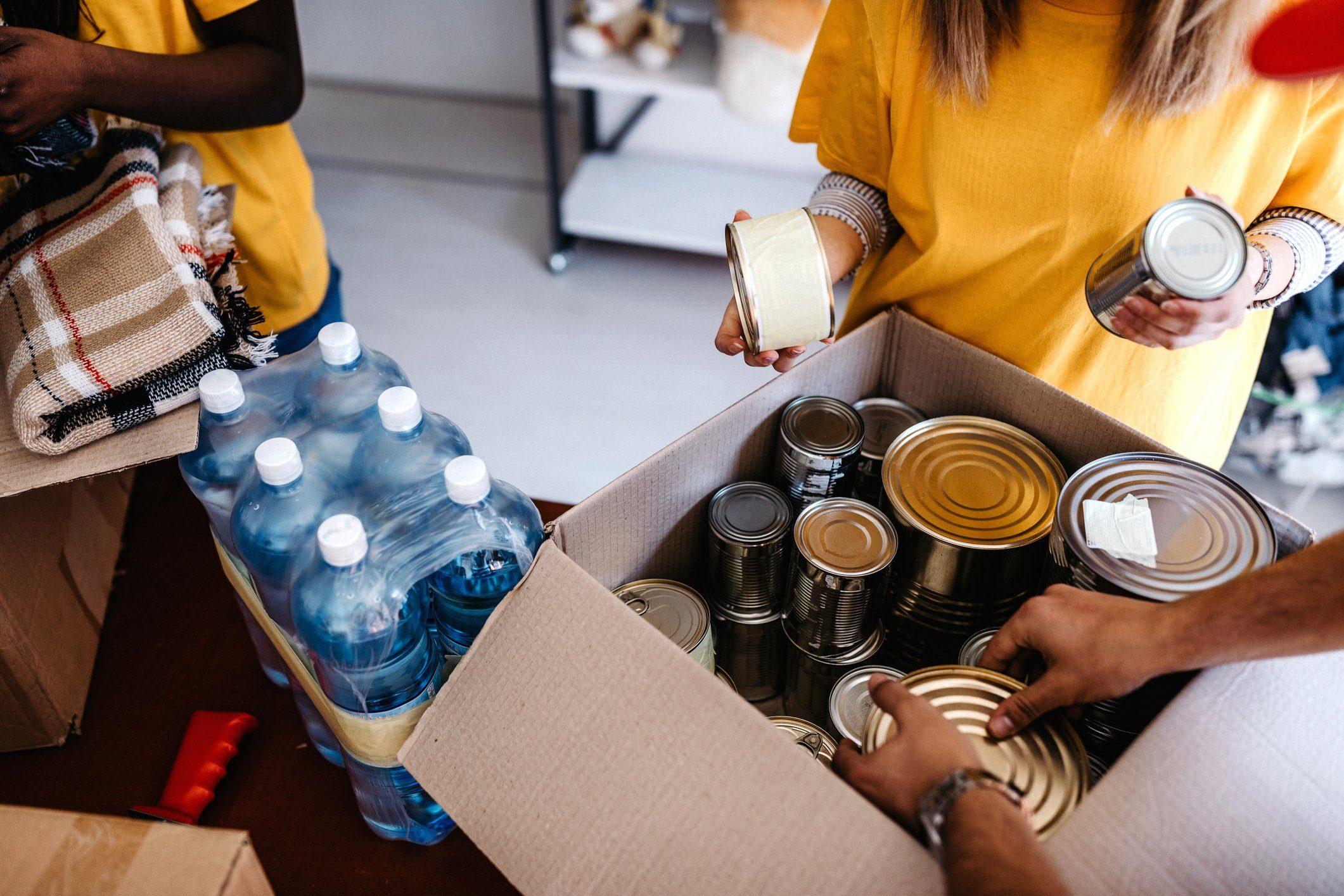 Generous people helping to poor people
