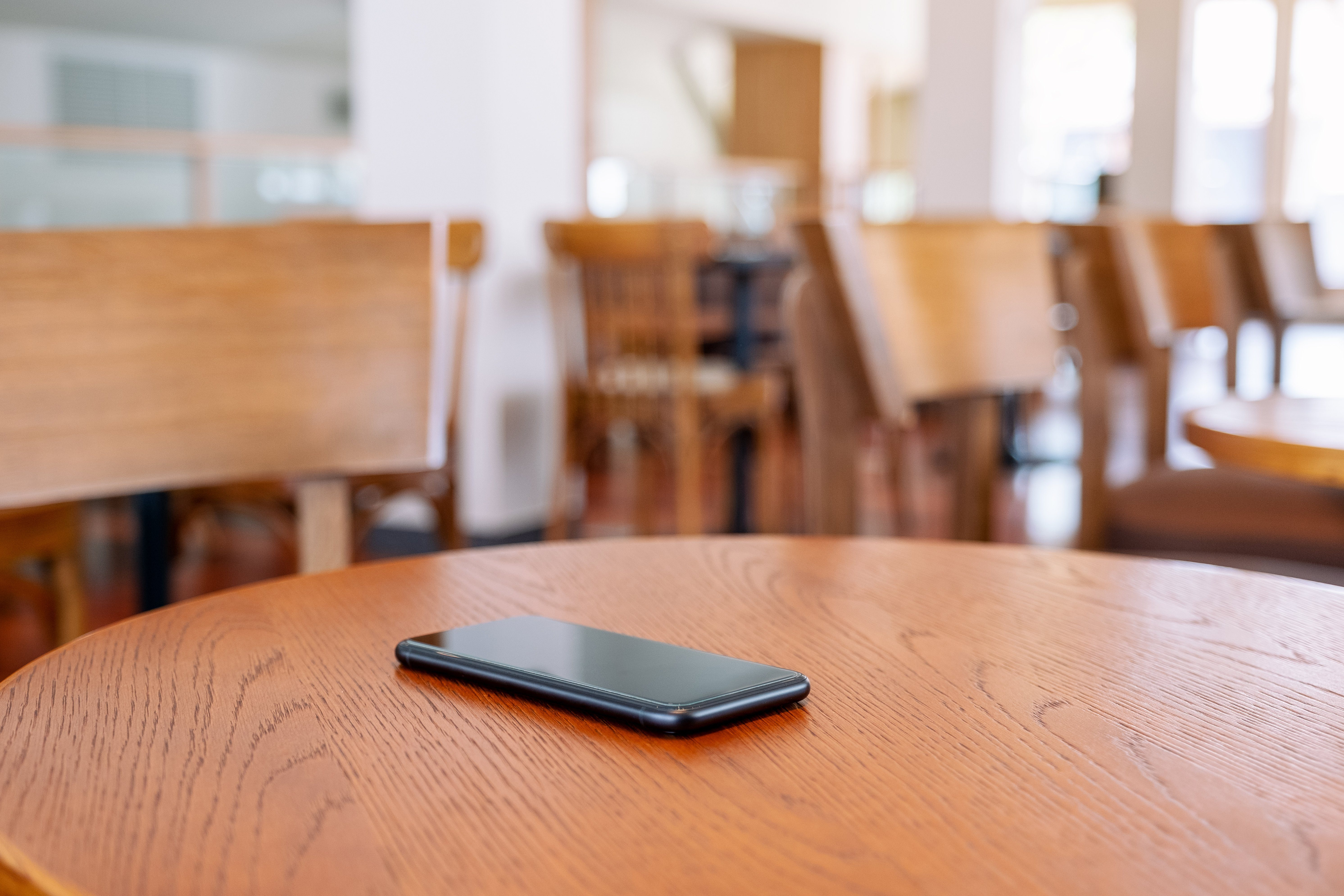 a black mobile phone on the table