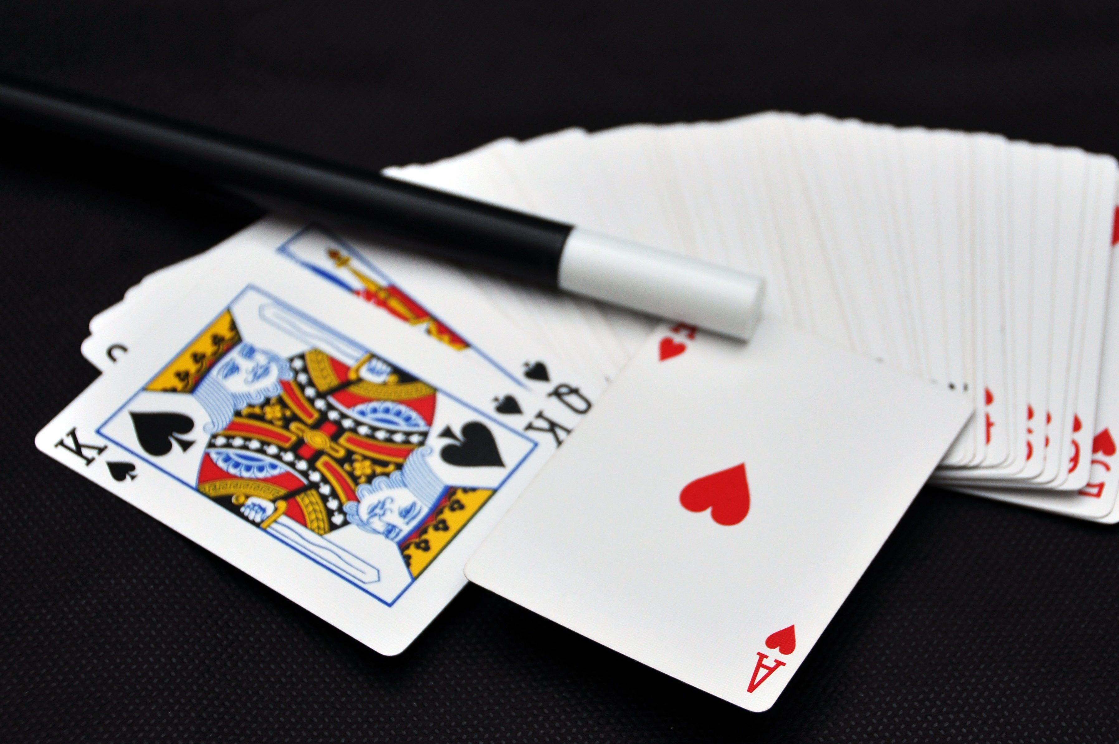 Playing card with magic wand