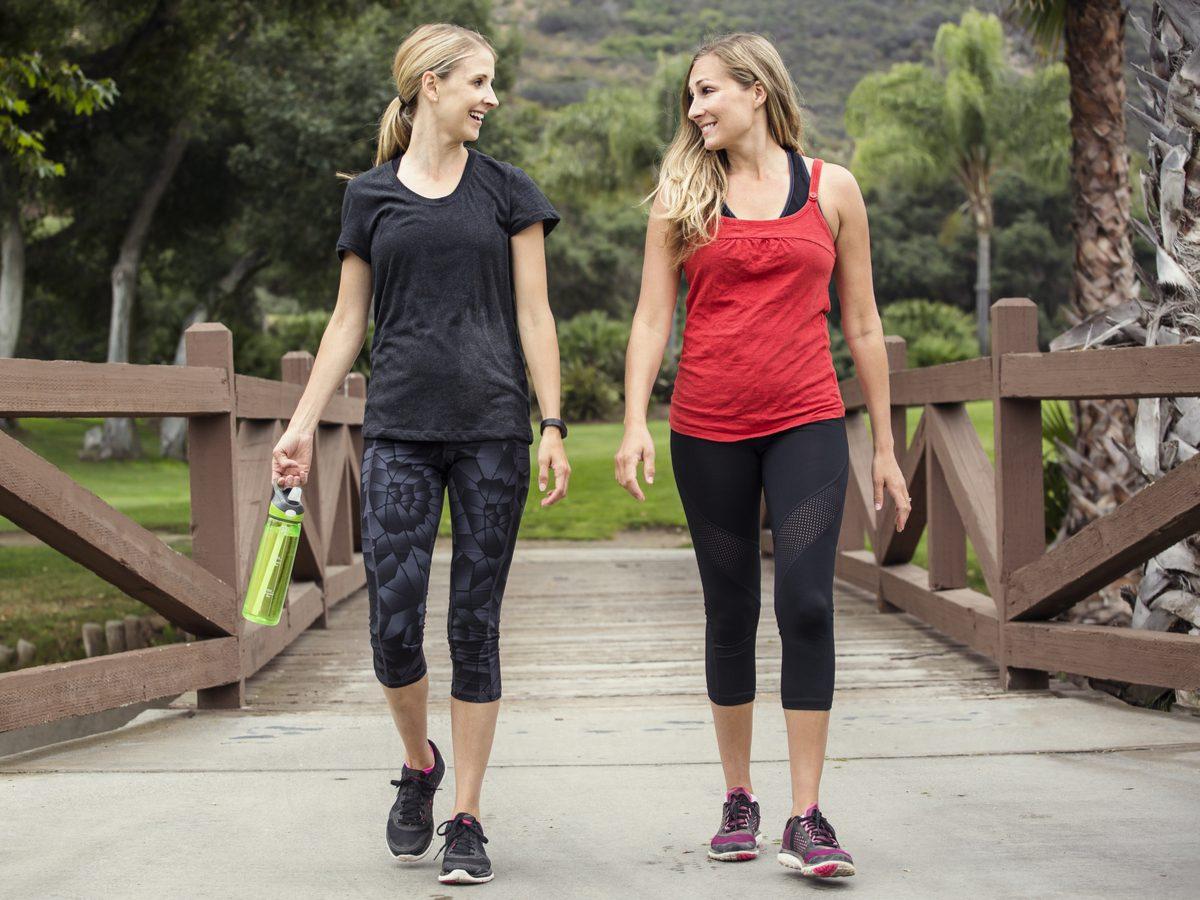 Two Caucasian women walking in athletic wear