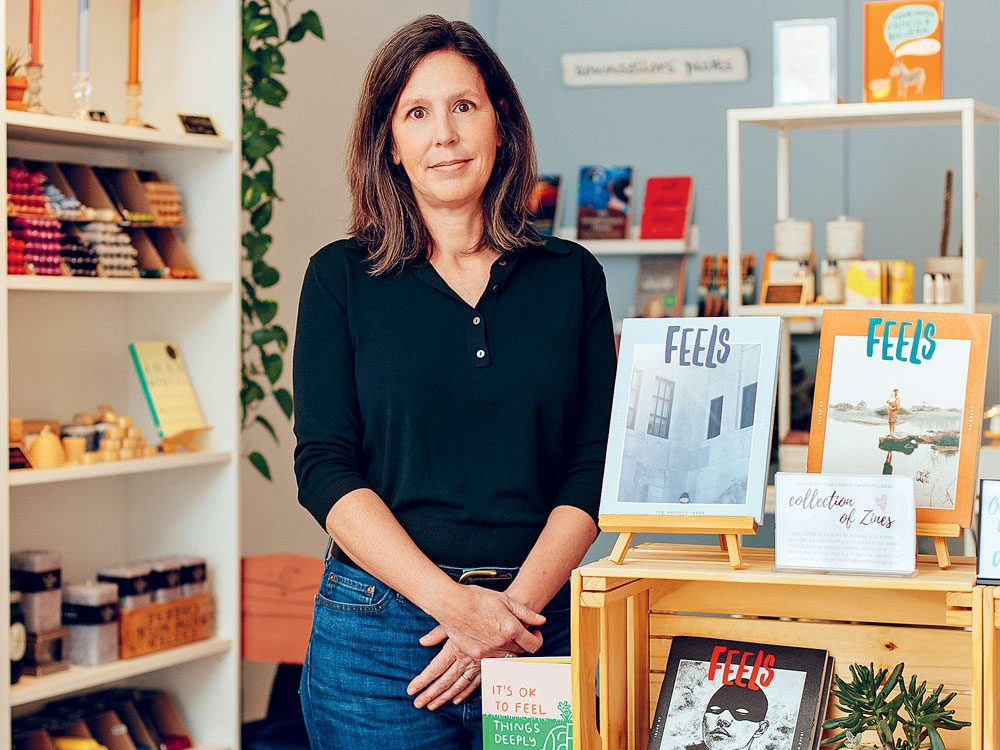 Hard Feelings founder Kate Scowen stands in front of a bookshelf at her mental health clinic.